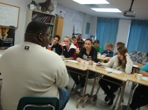 Darrius reads to the Secondary 1-2 English students. Photo: Brett Mitchell